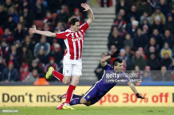 Stoke City's Philipp Wollscheid challenges Manchester City's Sergio Aguero