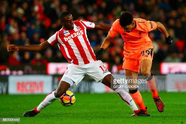 Stoke City's Portugueseborn Dutch defender Bruno Martins Indi vies with Liverpool's English striker Dominic Solanke during the English Premier League...