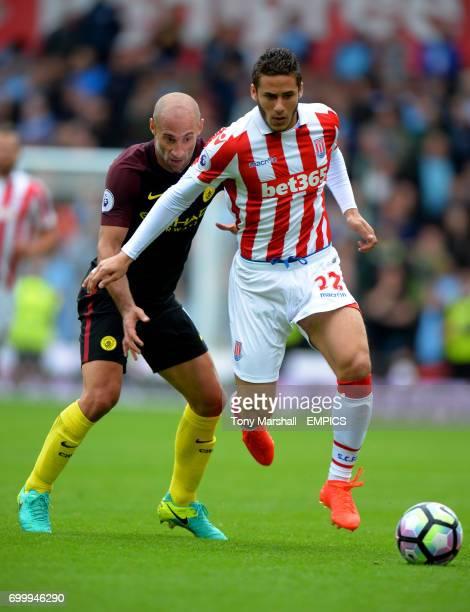 Stoke City's Ramadan Sobhi and Manchester City's Pablo Zabaleta battle for the ball