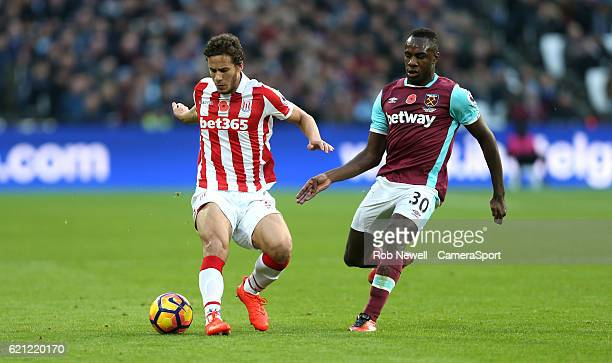 Stoke City's Ramadan Sobhi and West Ham United's Michail Antonio during the Premier League match between West Ham United and Stoke City at Olympic...