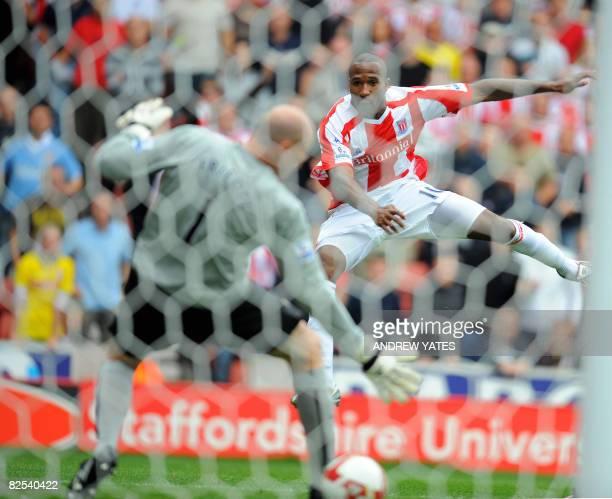 Stoke City's Ricardo Fuller scores past Aston Villa's US goalkeeper Brad Friedel during the Premier league football match at The Britannia Stadium in...