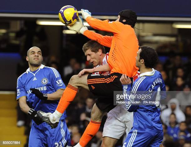 Stoke City's Richard Cresswell and Chelsea goalkeeper Petr Cech battle for the ball