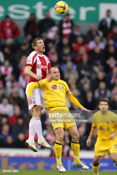 Stoke City's Richard Cresswell and Fulham's Danny Murphy battle for a ball in the air