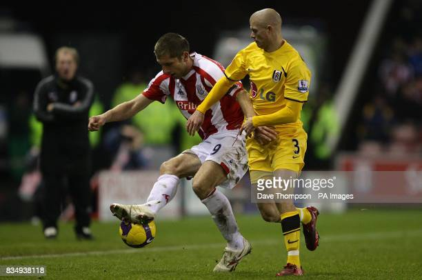 Stoke City's Richard Cresswell and Fulham's Paul Konchesky battle for the ball