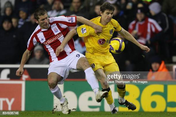 Stoke City's Richard Cresswell and Fulham's Zoltan Gera battle for the ball