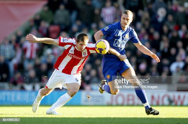 Stoke City's Richard Cresswell and Manchester United's Nemanja Vidic in action