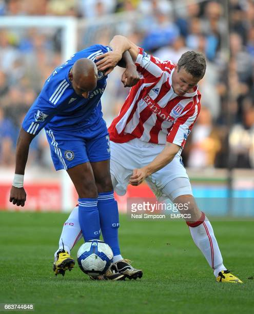 Stoke City's Robert Huth and Chelsea's Nicolas Anelka battle for the ball