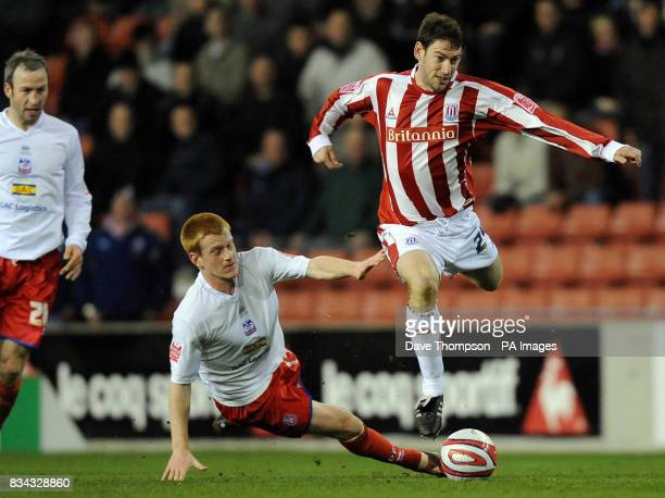 Stoke City's Rory Delap and Crystal Palace's Ben Watsoni in action during the CocaCola Championship match at the Britannia Stadium StokeonTrent