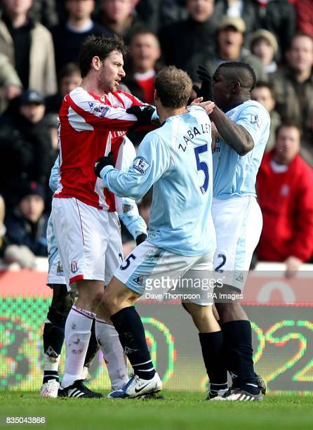 Stoke City's Rory Delap is confronted by Manchester City's Pablo Zabaleta and Micah Richards following a foul on Manchester City's Shaun...