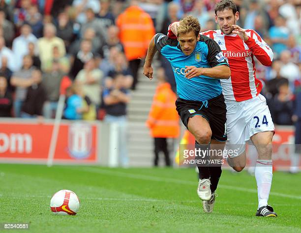 Stoke City's Rory Delap vies with Aston Villa's Bulgarian midfielder Stiliyan Petrov during the Premier league football match at The Britannia...
