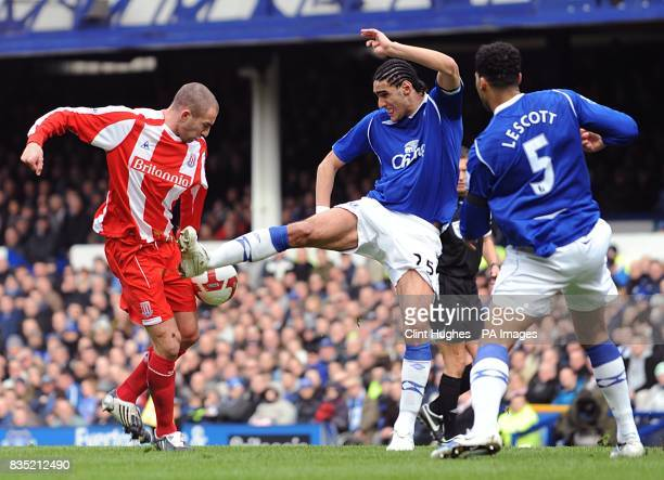 Stoke City's Ryan Shawcross and Everton's Marouane Fellaini battle for the ball