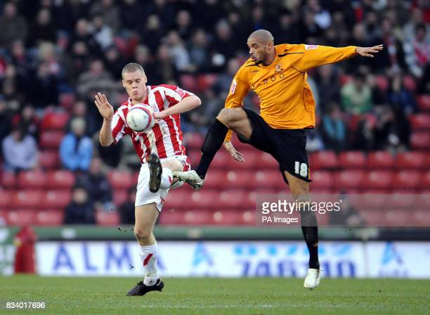 Stoke City's Ryan Shawcross and Hull City's Caleb Folan in action during the CocaCola Football Championship match at the Britannia Stadium Stoke