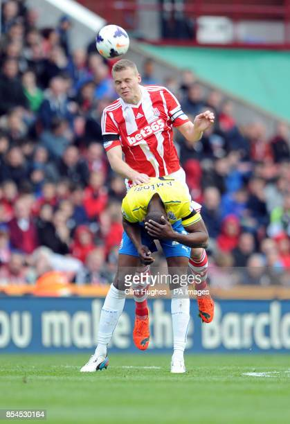 Stoke City's Ryan Shawcross and Newcastle United's Shola Ameobi battle for the ball during the Barclays Premier League match at the Britannia Stadium...