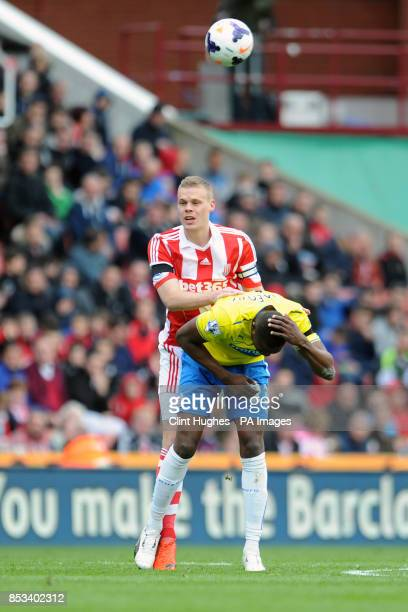 Stoke City's Ryan Shawcross and Newcastle United's Shola Ameobi get up close and personal