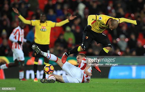 Stoke City's Ryan Shawcross and Watford's Adlene Guedioura battle for the ball during the Premier League match at the Bet365 Stadium Stoke
