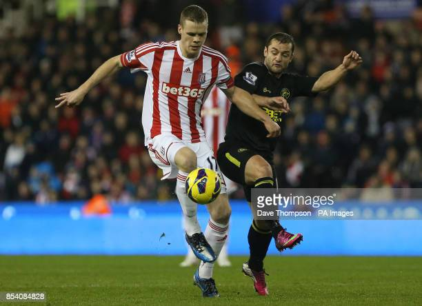Stoke City's Ryan Shawcross and Wigan Athletic's Shaun Maloney in action during the Barclays Premier League match at the Britannia Stadium Stoke on...