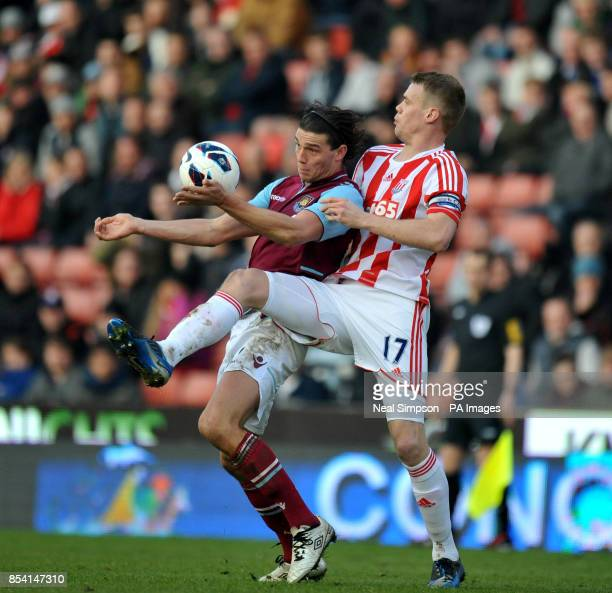 Stoke City's Ryan Shawcross challenges West Ham United's Andy Carroll during the Barclays Premier League match at the Britannia Stadium Stoke