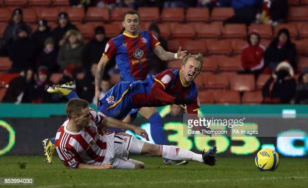 Stoke City's Ryan Shawcross fouls Crystal Palace's Jonathan Williams to conced a late penalty during the FA Cup Third Round Replay at the Britannia...