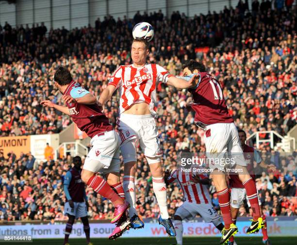 Stoke City's Ryan Shawcross gets between West Ham United's Matt Jarvis and Joey O'Brien during the Barclays Premier League match at the Britannia...