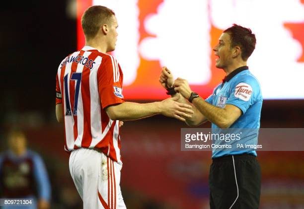 Stoke City's Ryan Shawcross has words with referee Mark Clattenburg during the Barclays Premier League match at the Britannia Stadium Stoke On Trent