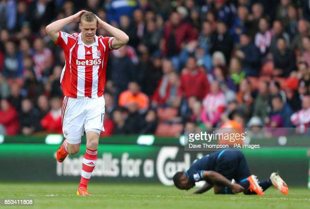 Stoke City's Ryan Shawcross holds his head after fouling Tottenham Hotspur's Danny Rose and receiving his second yellow card during the Barclays...