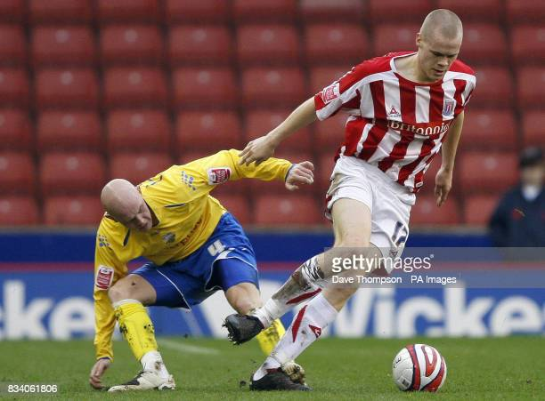 Stoke City's Ryan Shawcross right and Preston's Richard Chaplow during the CocaCola Championship match at Britannia Stadium Stoke