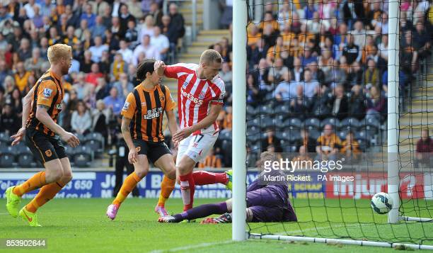 Stoke City's Ryan Shawcross scores his teams first goal against Hull City during the Barclays Premier League match at the KC Stadium Hull