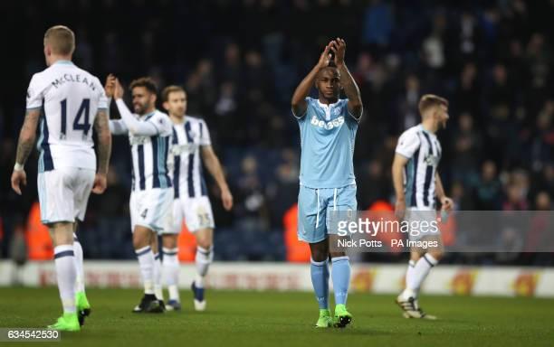 Stoke City's Saido Berahino applauds the travelling fans