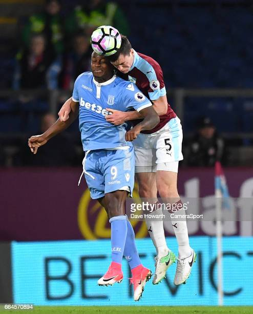 Stoke City's Saido Berahino battles with Burnley's Michael Keane during the Premier League match between Burnley and Stoke City at Turf Moor on April...