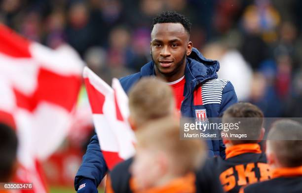 Stoke City's Saido Berahino greets children from St Kevin's Boys FC before the game