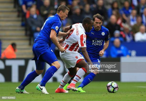 Stoke City's Saido Berahino is challenged by Leicester City's Robert Huth during the Premier League match at the King Power Stadium Leicester