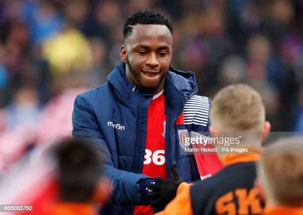 Stoke City's Saido Berahino shakes hands with children from St Kevin's Boys FC before the game