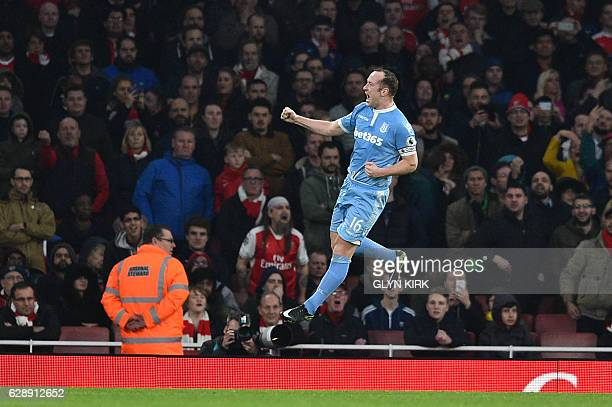 Stoke City's Scottish midfielder Charlie Adam celebrates after scoring their first goal during the English Premier League football match between...