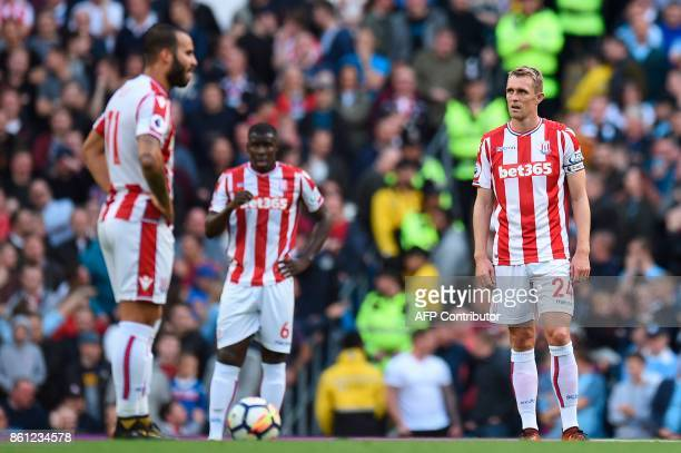 Stoke City's Scottish midfielder Darren Fletcher reacts as Stoke wait for the restart after conceding a goal during the English Premier League...
