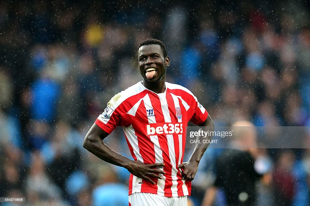 Stoke City's Senegalese forward Mame Biram Diouf, who scored Stoke City's winning goal, reacts at the final whistle during the English Premier League football match between Manchester City and Stoke City at the Etihad Stadium in Manchester, north-west England on August 30, 2014. Stoke City won the match 1-0. AFP PHOTO / CARL COURT USE. No use with unauthorized audio, video, data, fixture lists, club/league logos or live services. Online in-match use limited to 45 images, no video emulation. No use in betting, games or single club/league/player publications