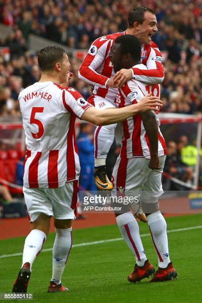 Stoke City's Senegalese striker Mame Biram Diouf celebrates with Stoke City's Swiss forward Xherdan Shaqiri and Stoke City's Austrian defender Kevin...