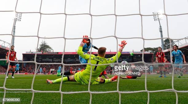 Stoke City's Senegalese striker Mame Biram Diouf shoots past Bournemouth's Polish goalkeeper Artur Boruc to scores his team's second goal during the...