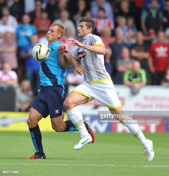 Stoke City's Steve Sidwell and Burton Albion's John Mousinho battle for the ball during the PreSeason friendly at The Pirelli Stadium BurtonUponTrent