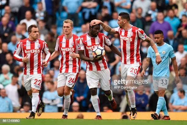 Stoke City's Swiss forward Xherdan Shaqiri Stoke City's Scottish midfielder Darren Fletcher Stoke City's Senegalese striker Mame Biram Diouf and...