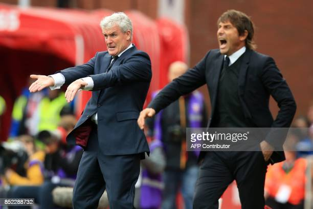 Stoke City's Welsh manager Mark Hughes and Chelsea's Italian head coach Antonio Conte gesture on the touchline during the English Premier League...