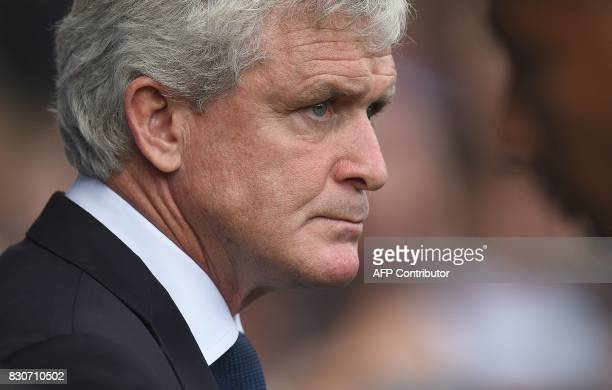 Stoke City's Welsh manager Mark Hughes arrives ahead of the English Premier League football match between Everton and Stoke City at Goodison Park in...