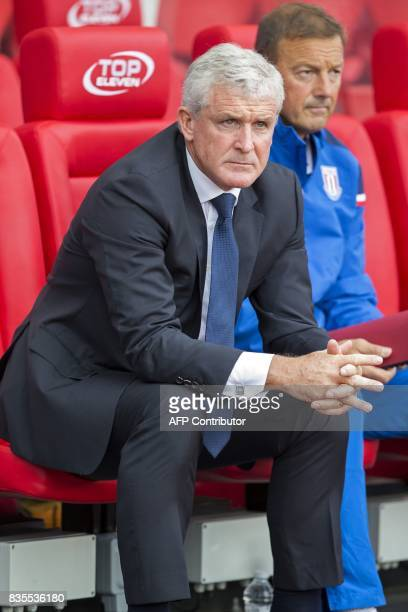 Stoke City's Welsh manager Mark Hughes awaits kick off in the English Premier League football match between Stoke City and Arsenal at the Bet365...
