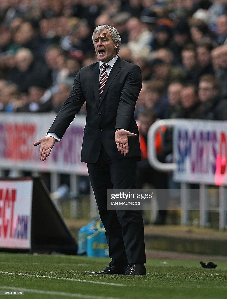Stoke City's Welsh manager Mark Hughes gestures during the English Premier League football match between Newcastle United and Stoke City at St James' Park in Newcastle-upon-Tyne, northeast England on December 26, 2013. Newcastle won the game 5-1. USE. No use with unauthorized audio, video, data, fixture lists, club/league logos or live services. Online in-match use limited to 45 images, no video emulation. No use in betting, games or single club/league/player publications.