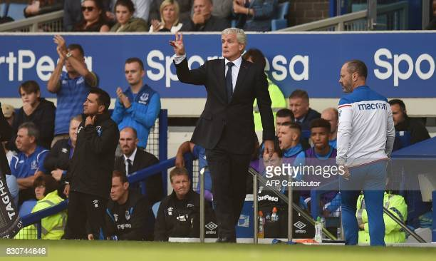 Stoke City's Welsh manager Mark Hughes gestures during the English Premier League football match between Everton and Stoke City at Goodison Park in...