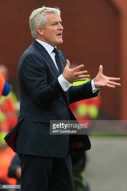 Stoke City's Welsh manager Mark Hughes gestures on the touchline during the English Premier League football match between Stoke City and Chelsea at...