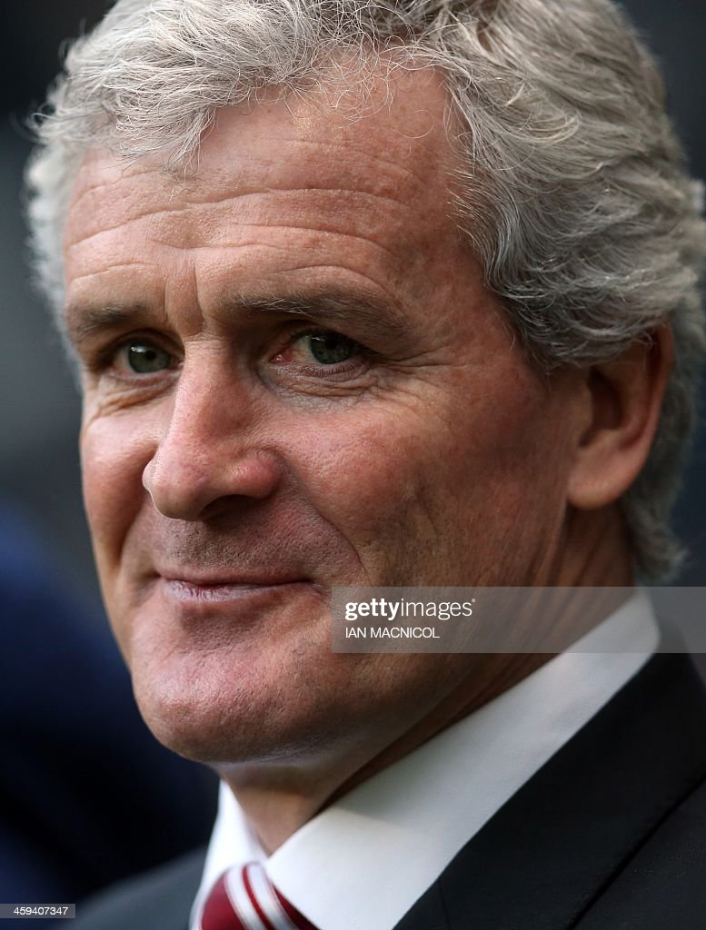 Stoke City's Welsh manager Mark Hughes looks on before the English Premier League football match between Newcastle United and Stoke City at at St James' Park in Newcastle-upon-Tyne, northeast England on December 26, 2013. Newcastle won the game 5-1. USE. No use with unauthorized audio, video, data, fixture lists, club/league logos or live services. Online in-match use limited to 45 images, no video emulation. No use in betting, games or single club/league/player publications.