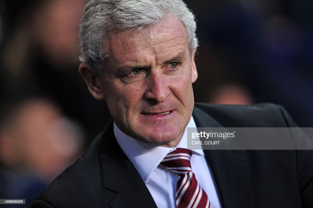 Stoke City's Welsh manager Mark Hughes looks on before the English Premier League football match between Tottenham Hotspur and Stoke City at White Hart Lane in north London on December 29, 2013. USE. No use with unauthorized audio, video, data, fixture lists, club/league logos or live services. Online in-match use limited to 45 images, no video emulation. No use in betting, games or single club/league/player publications.