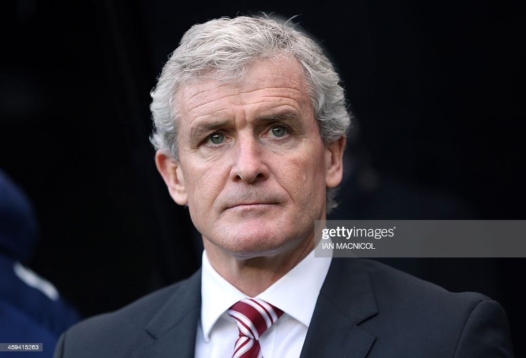 Stoke City's Welsh manager Mark Hughes looks on during the English Premier League football match between Newcastle United and Stoke City at St James' Park in Newcastle-upon-Tyne, northeast England on December 26, 2013. Newcastle won the game 5-1. USE. No use with unauthorized audio, video, data, fixture lists, club/league logos or live services. Online in-match use limited to 45 images, no video emulation. No use in betting, games or single club/league/player publications.