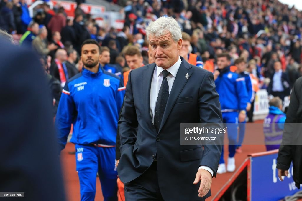 Stoke City's Welsh manager Mark Hughes reacts as he leaves the touchline during the English Premier League football match between Stoke City and Chelsea at the Bet365 Stadium in Stoke-on-Trent, central England on September 23, 2017. Chelsea won the game 4-0. / AFP PHOTO / Lindsey PARNABY / RESTRICTED TO EDITORIAL USE. No use with unauthorized audio, video, data, fixture lists, club/league logos or 'live' services. Online in-match use limited to 75 images, no video emulation. No use in betting, games or single club/league/player publications. /