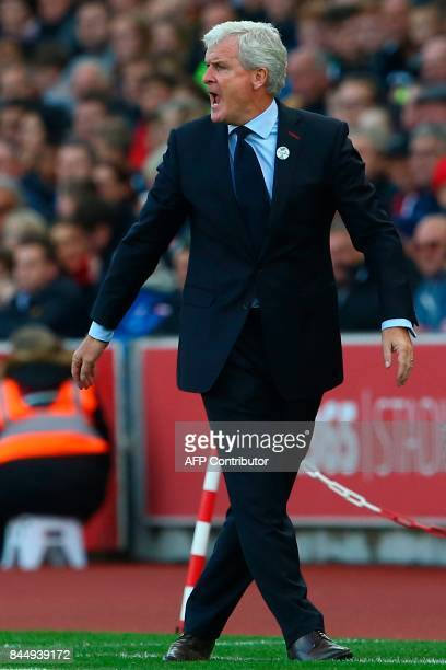 Stoke City's Welsh manager Mark Hughes reacts on the touchline during the English Premier League football match between Stoke City and Manchester...